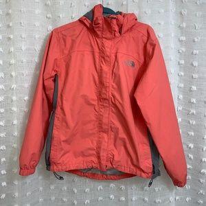 Neon pink Women's North Face Rain Jacket.